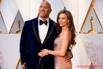 Dwayne Johnson arrives with Lauren Hashian