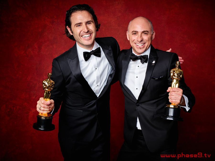 """Alan Barillaro and Marc Sondheimer poses backstage with the Oscar for Best animated short film, for work on """"Piper"""""""