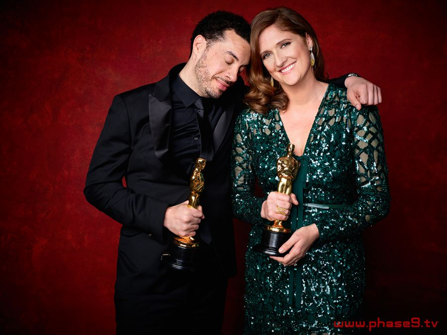 "Ezra Edelman and Caroline Waterlow pose backstage with the Oscar for Best documentary feature, for work on ""O.J. Made in America"""