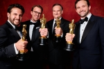"Adam Valdez, Andrew R. Jones, Robert Legato and Dan Lemmon pose backstage with the Oscar for Achievement in visual effects, for work on ""The Jungle Book"""