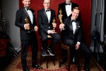 "Andy Wright, Kevin O'Connell Peter Grace and Robert Mackenzie pose backstage with the Oscar for Achievement in sound mixing, for work on ""Hacksaw Ridge"""