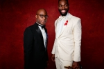 """Barry Jenkins and Tarell Alvin McCraney poses backstage with the Oscar for Adapted screenplay, for work on """"Moonlight"""""""