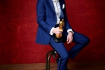 """Damien Chazelle poses backstage with the Oscar for Achievement in directing, for work on """"La La Land"""""""