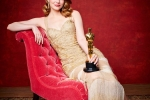 "Emma Stone poses backstage with the Oscar for Performance by an actress in a leading role, for work on ""La La Land"""