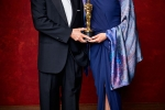"""Firouz Naderi and Anousheh Ansari accepting for Ashgar Farhadi with the Oscar for Best foreign language film of the year, for work on """"The Salesman"""" from Iran"""