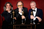 "Giorgio Gregorini, Alessandro Bertolazzi and Christopher Nelsoni poses backstage with the Oscar for Achievement in makeup, for work on ""Suicide Squad"""