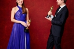 "Joanna Natasegara and Orlando von Einsiedel pose backstage with the Oscar for Best documentary short subject, for work on ""The White Helmets"""