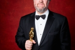 """Kenneth Lonergan poses backstage with the Oscar for Original screenplay, for work on """"Manchester by the Sea"""""""