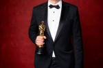 """Sylvain Bellemare pose backstage with the Oscar for Achievement in sound editing, for work on """"Arrival"""""""