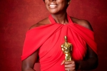 "Viola Davis poses backstage with the Oscar for Performance by an actress in a supporting role, for work on ""Fences"""
